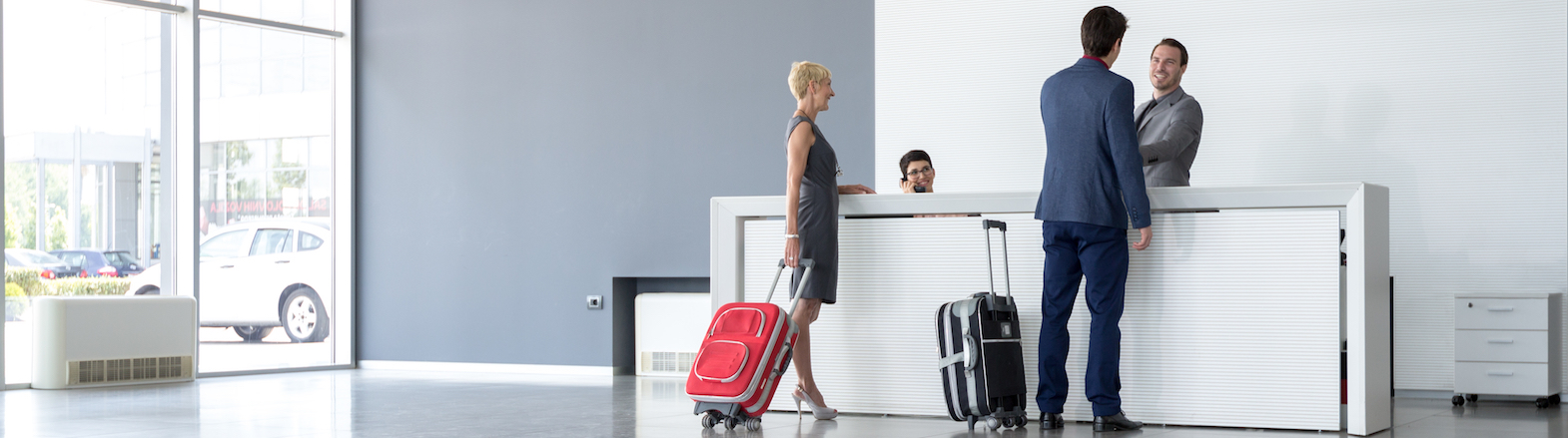Man And Woman At Check In Desk